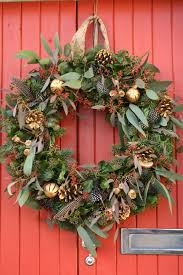 christmas wreath with feathers eucalyptus berries and cones
