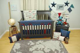 navy and red vintage airplane crib bedding set in a transportation