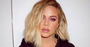 iconic earrings khloe proves she s one of us by buying iconic hoop