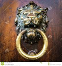 brass door knocker on wooden door stock photo image 58819911