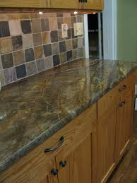 Under The Cabinet Lights by Green Marble Setting Off A Random Slate Backsplash And Custom Oak