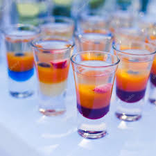 beautiful line of different colored cocktails with smoke on a