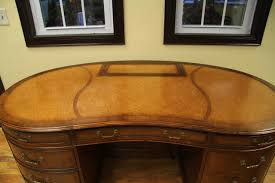 kidney shaped executive desk walnut leather top kidney desk with hidden monitor lift