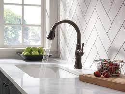faucet delta dst running in spray mode venetian bronze com rb by
