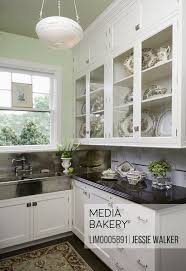 rustic glass kitchen cabinets photo by sheltered images kitchen classic and modern mix butler s pantry vintage german silver sink new cambria quartz counters in brown