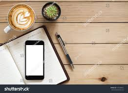 Wooden Table Top View Office Desk Blank Screen Smartphonepennotebook Coffee Stock Photo