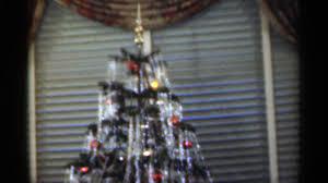1949 presenting a doll under christmas tree enjoying a