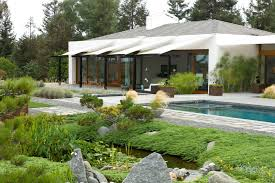 patio shade sails landscape modern with awning boulders entry