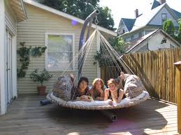 joyous big round porch swing with stand from metal on small deck