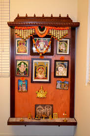 home mandir decoration mandir set up in a wooden cabinet placed