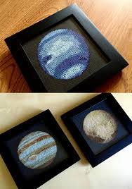 a cross stitched solar system by navid baraty colossal