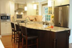 tremendous antique white kitchen with dark island and cylinder