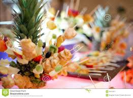 artistic appetizer with fruits and cookies at cocktail party