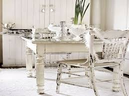 white wooden dining table and chairs on white fur rug added by