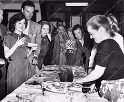 candid behind the scenes bette davis serving birthday cake payment