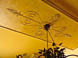 venetian plaster with applied ornament enhance this classic