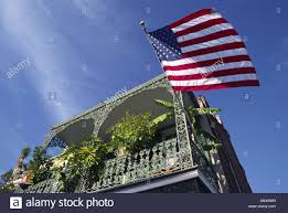 French And American Flags American Flag U0026 Wrought Iron Balcony In The French Quarter Usa