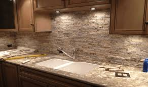stacked stone backsplash at awesome copper accent kitchen hardware