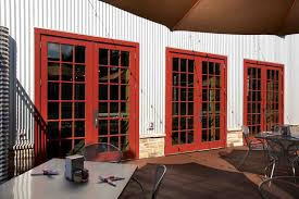 Wood Patio French Doors - three red stained wooden patio door and striped pattern white