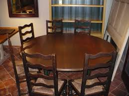 100 60 inch round dining table seats how many black round