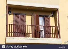 modern pvc sun shutter blinds on balcony doors and windows of