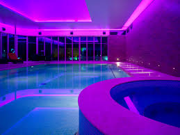 swimming pool indoor pool lights with purple and blue taken from