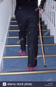 Pain Climbing Stairs old woman climbing steps stock photos u0026 old woman climbing steps