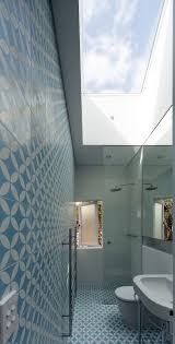 bathroom bathroom blue pattern tile floor walk in shower with
