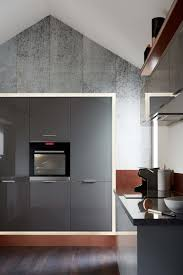 Slab Door Kitchen Cabinets by A High Gloss Slate Grey Slab Door Creates A Modern Look Matched
