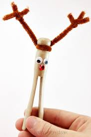 clothespin reindeer ornament housing a forest
