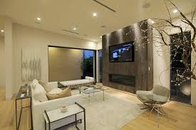 contemporary living room with hardwood floors by lang lequang