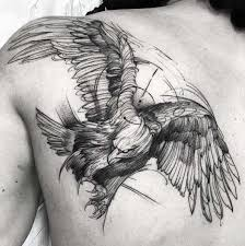 geometric sketch style flying eagle tattooed on left back shoulder