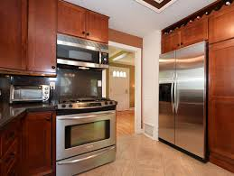 modern kitchen floor open kitchen floor design with white cabinets and silver steel