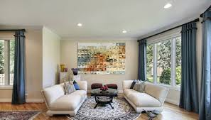 nice blue curtains on the small windows interior living room with