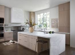 minimalist kitchen area with light brown plywood kitchen cabinet