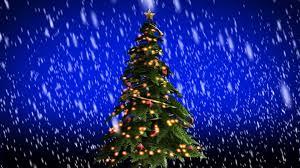 beautiful christmas snow falling on christmas tree free