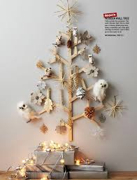 the wooden wall tree from west elm is a way to display