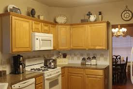 country decor above kitchen cabinets sleek stainless steel oven