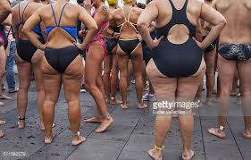 picture of heavy set women in a two piece bathing suit fat women in bathing suits stock photos and pictures getty images