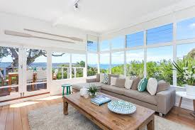 coastal style decorating ideas hang a sunny textile 15 spring decorating ideas coastal style 5