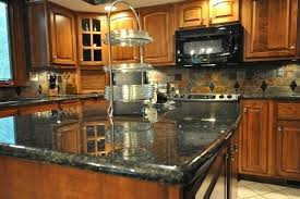 pictures of kitchen backsplashes with granite countertops granite countertops with backsplash ideas for busy granite