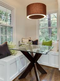 coastal dining table saltaire restoration loversiq photos hgtv contemporary dining space with built in bench seating glass table and mix of chocolate dining room