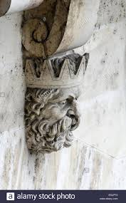 the carved of a bearded king ornaments a corbel underneath