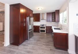 what color flooring to use with cherry cabinets gray wood floors warm cherry cabinets white counters