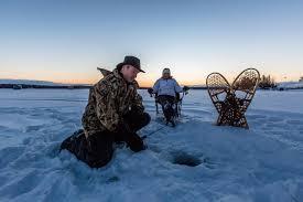 couples ice fishing on lake nosbonsing northern ontario travel