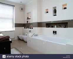 modern bathrooms tiled in white and brown tiles his and hers wash