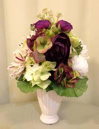 Peony Floral Arrangement by Dahlia Peony Ranunculus And Hydrangea Arrangement In Cream