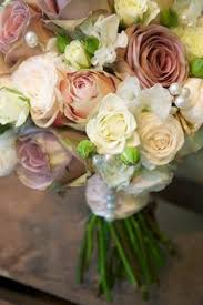 wedding flowers near me vinatge look handtie of dusky pink lilac roses with and