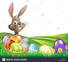 cartoon easter bunny with a hamper of chocolate easter eggs in a