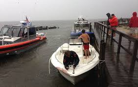 marine bureau marine bureau officers rescued thrown from his boat by a wave in